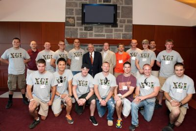 student veterans with University President Charles W. Steger during football game